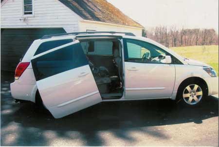 Client photo of the mini-van door falling off.